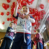 MARY SCHWALM/Staff photo Kids play with balloons at a Santa Function at Austin Prep in Reading. 12/8/13