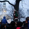 MARY SCHWALM/Staff photo Santa plugs in the power for the annual tree lighting on the common in Reading.  12/1/13