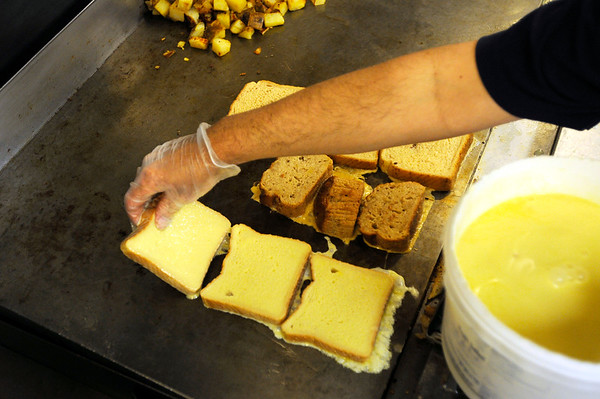 Breakfast at Christopher's Restaurant.  <br /> Chrisopher Cushing prepares French toast  on the grill. PAUL BILODEAU/Staff photo.