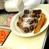 Breakfast at Christopher's Restaurant. A little bit of powdered sugar is put  on french toast. PAUL BILODEAU/Staff photo.