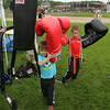 MARIA UMINSKI/READING MAGAZINE 5 year-old Nathan Bettencourt of Tewksburry and 3 year-old brother Brayden test out their boxing skills at the Title Boxing Club tent during the Reading Friends and Family Day at Birch Meadow Park on June 14, 2014.