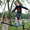 MARIA UMINSKI/READING MAGAZINE Members of Troop 702 spot 6 year-old Tyler Marchilk of Reading as he climbs their ropes course during the Reading Friends and Family Day at Birch Meadow Park on June 14, 2014.