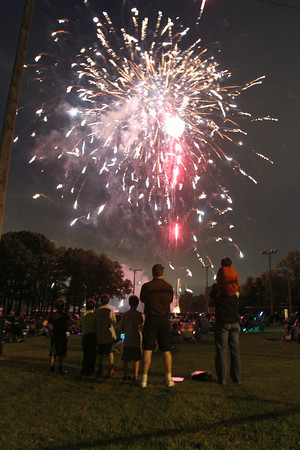 MARIA UMINSKI/THE READING MAGAZINE Residents watch the fireworks display in Birch Meadow Park in Reading on June 14 2014.