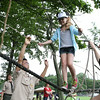MARIA UMINSKI/READING MAGAZINE Members of Troop 702 spot 8 year-old Bryn Connelly of Reading as she climbs their ropes course during the Reading Friends and Family Day at Birch Meadow Park on June 14, 2014.