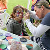MARIA UMINSKI/READING MAGAZINE 7 year-old Solana Maldonado gets her face painted by Judianne Gillis at the Reading Orthodontics Tent during the Reading Friends and Family Day at Birch Meadow Park on June 14, 2014.