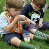 MARIA UMINSKI/READING MAGAZINE Brothers 2 year-old Rowan and 4 year-old Cuan Demers of reading enjoy their slushes during the Reading Friends and Family Day at Birch Meadow Park on June 14, 2014. RFFD is the start of summer celebration put on by the Readings Lions club.