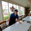 RYAN HUTTON/ Staff photo.<br /> CLASS worker Stacey Francis working at the North Reading McDonalds.
