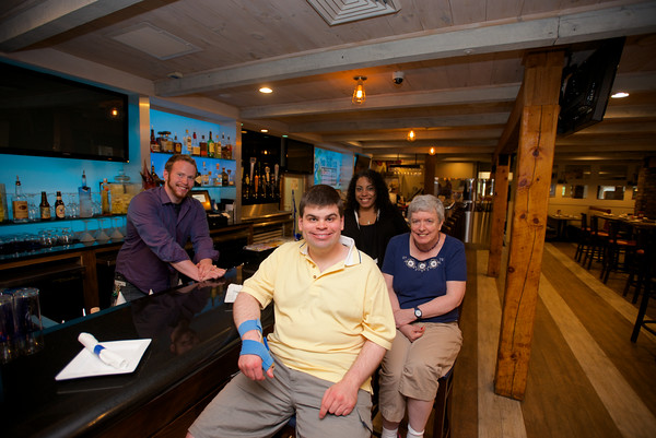 RYAN HUTTON/ Staff photo.<br /> From left, Joe Fish Restaurant Manager Stephen Holasek, CLASS worker David Demuth, Joe Fish Restaurant Manager Glondy Pena, and CLASS worker Janice Cady.