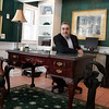 Readings Magazine<br /> Rick Nazzaro sits at a desk that was once owned by Orson Welles that is now at Colonial Manor Reality.<br /> Photo by Amy Sweeney<br /> 25th anniversary of Colonial Manor Reality in Reading.