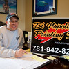 RYAN HUTTON/ Staff photo.  <br /> Gary DiNapoli, owner of DiNapoli Painting Inc. in his Reading, MA office.