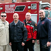 MARY SCHWALM/Staff photo North Reading fire Captain Eric Pepper, left, Chief William Warnock, Firefighter Jon Burt and Captain Don Stats pose for a photo in front of the Essex County Technical Rescue truck in North Reading. The four are members of the Essex County Techincal Rescue team. Pepper is the Director, Warnock is the Operational Chief, Burt is the equipment manager, and Stats is the B Team Squad leader.   3/31/14