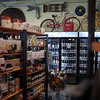 MARY SCHWALM/Staff photo A selection of refrigerated craft beers among groceries and vintage bicycles. 3/25/14