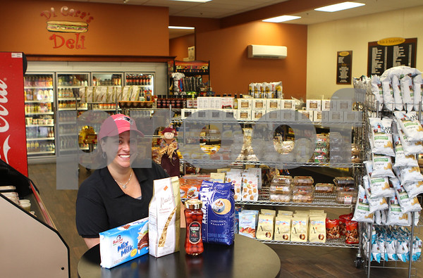 Jill DiCara sits in DiCara's Deli located at 1349 Main Street in Reading. <br /> AMY SWEENEYStaff photo. 10/2/14