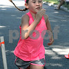 Twelve year-old Caroline Stanton of Reading finished first in the girls category for the The Fall Street Five-K in Reading with a time of 21:07. Photo by Maria Uminski