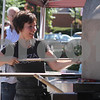 Anna Peppe of North Reading puts a pizza into the portable brick oven at the Pizza Goddess tent during the Reading Fall Street Faire. Pizza Goddess is a brick oven catering company out of North Reading. Photo by Maria Uminski