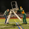 Band director Eric Forman, left, and base player Peter Spinelli move equipment during a home football game against Newburyport September 30, 2014.  Photo by Reba Saldanha