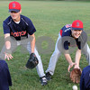 Ryan Dinapoli and Shawn DiVecchia catch ground balls during a grounders drill. Dinapoli and DiVecchia were a part of the Youth Baseball team that traveled to Italy this past summer for a baseball tournament and placed third.