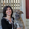 MARY SCHWALM/Staff photo Julie Dunn and her mixed breed dog Jack pose for a photo on a bench at the Bed and Biscuit doggie daycare in Reading 9/19/13