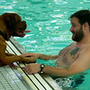 Mat Bruso and his dog Titus share a moment at the Reading YMCA pool. The Pool was open to dogs and their owner to swim in just before it was scheduled to be washed. Owners paid $20 for a half hour swim with all proceeds going to the Annual Fund, which provide services at the Y to people who can afford them.