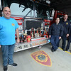 JIM VAIKNORAS/Staff photo Reading firefighters From left Matt McSheehey(ret), Joe Lapolla, Tony DelSignore, Peter Marchetti with just a sample of their awards and trophies for chilli.