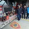 JIM VAIKNORAS/Staff photo Reading firefighters From left  Joe Lapolla, Tony DelSignore, Peter Marchetti , and Matt McSheehey(ret), with just a sample of their awards and trophies for chilli.