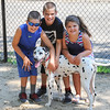 AMANDA SABGA/ Staff photo <br /> <br /> 11-month old Dalmatian, Mighty, lives in Reading but explores the local Andover Dog Park. Mighty go this name from his breeder despite his family having other names picked out. When he arrived from Ohio and heard about his brother Meaty they decided the name suited him. <br /> <br /> Here Mighty is with his family  Reily, 9, Carter, 11, and Mia Learned, 7.<br /> <br /> 7/13/16