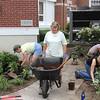 Courtesy Photo by Denise McCarthy. This is Lauri Johnson wheeling the barrow while planting one of the new sections back in July 2013.  On her left is Ania Knap( member of garden club) and on her right are Andy Slezak<br /> and Tiffany Keyes (both former employees of Lauri Johnson).  Photo by Denise McCarthy