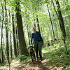 AMY SWEENEY/Staff photo. <br /> Vinny Landers from North Andover walks with his Labradoodle Maggie on the hosted walk through Harold Parker State Forest.<br /> <br /> Harold Parker State Forest hosts walks every Wednesday. Rain, sleet, sun or snow.<br /> The Park Interpreter and volunteer leaders guide a slow paced walk through the forest while enjoying nature at its finest. Each week we hike to a different part of the forest for a series of 12 hikesMay 25, 2016