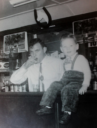 Pat Lee, owner of the Horseshoe Grille in North Reading as a little boy sitting on top of the bar with his father. 7/18/2016.