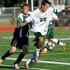 CARL RUSSO/Staff photo. Pentucket defeated North Reading 1-0 in boys' soccer action Monday afternoon. Pentucket senior, Zack Chapman scored the winning goal. Pentucket's Dylan Wright (left) gives chase as North Reading's captain, John Braga gains control of the ball. 9/17/2012.