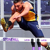 Courtesy photo<br /> <br /> North Reading resident John Braga, shown here jumping hurdles, just missed qualifying for the nationals in the decathlon for Merrimack College.