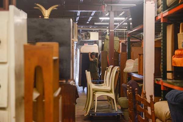 AMANDA SABGA/ Staff photo <br /> <br /> Mission of Deeds volunteer David Berube brings in a couch.<br /> <br /> 7/13/16