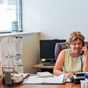 AMANDA SABGA/ Staff photo <br /> <br /> Mission of Deeds Janice Triglione-Weiner works the phones. Janice's father Tony Triglione founded Mission of Deeds. <br /> <br /> 7/13/16