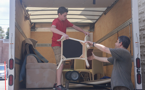 AMANDA SABGA/ Staff photo <br /> <br /> Mission of Deeds volunteers Kyle Hildreth and David Berube unload a truck full of donations. <br /> <br /> 7/13/16