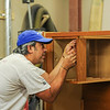 AMANDA SABGA/ Staff photo <br /> <br /> Mission of Deeds volunteer Andres Martin works on fixing up items in the shop. <br /> <br /> 7/13/16