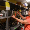 AMANDA SABGA/ Staff photo <br /> <br /> Mission of Deeds volunteer Joan Cascia organizes the pots and pans shelf in the kitchen and linens room. <br /> <br /> 7/13/16