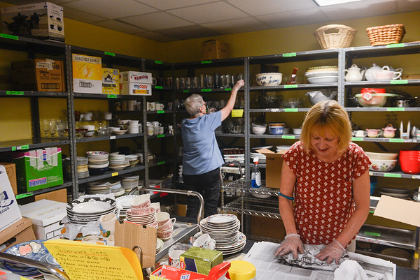 AMANDA SABGA/ Staff photo <br /> <br /> Mission of Deeds volunteers Janet Barbas and Marie Taylor work in the kitchen and linens room cleaning and packing glass and dish-ware. <br /> <br /> 7/13/16