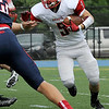 TIM JEAN/Staff photo<br /> Reading Memorial running back Nick DiNapoli runs for a short gain against Central Catholic High School during a football game at Veterans Memorial Stadium in Lawrence. Reading lost 28-6.  9/10/16