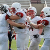 TIM JEAN/Staff photo<br /> Reading Memorial quarterback Corey Diloreto (7) celebrates scoring a touchdown with his teammates Zack Riffe (74), Ben Fischer (54), and Joe Bradley (33) during a football game against Central Catholic High School at Veterans Memorial Stadium in Lawrence. Reading lost 28-6.  9/10/16