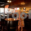 RYAN HUTTON/ Staff photo<br /> Bunratty Tavern owner Eilish Havey stands at one of the pub tables in her establishment.