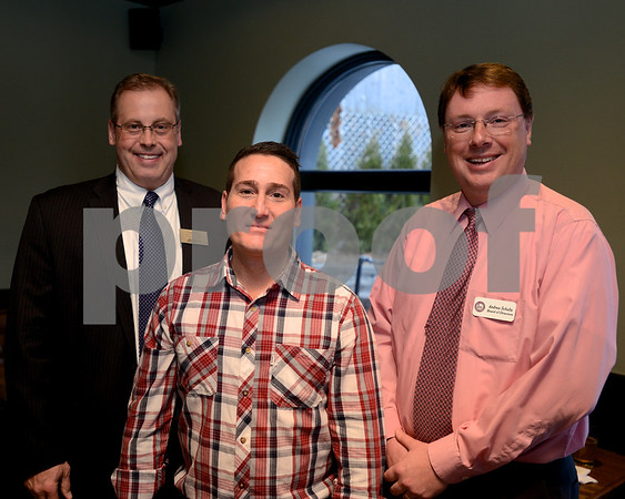 RYAN HUTTON/Staff photo<br /> Gregory Ryan, senior vice president of Reading Cooperative Bank, left, stands with Grumpy's Ale House General Manager Burke Fowler, center, and Andrew Schultz of the Reading/North Reading Chamber of Commerce Board of Directors at the Best of the Readings celebration at Grumpy's Ale House hosted by The Readings magazine and the Reading/North Reading Chamber of Commerce.