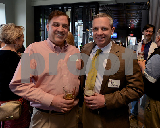 RYAN HUTTON/Staff photo<br /> From left, John Douglass of Pep's Peddler and Mike Conway of Conway Law, LLC at the Best of the Readings celebration at Grumpy's Ale House hosted by The Readings magazine and the Reading/North Reading Chamber of Commerce.