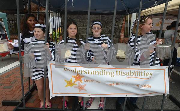 "JIM VAIKNORAS/Staff photo From the left Daniella McGilvray, Amara Bsichon,9, Annie Taylor, 13, Sophia Lorengetti, 13, and Janane Boranski, beg to be ""bailed out of jail"" as they raise money for Understanding Disabilities at the Reading Fall Street Fair.Understanding Disabilities provides disability awareness programming in the Reading Public Schools, to help children see beyond people's disabilities and focus on the ways that we are all the same inside.to learn more check out their web site <a href=""http://www.understandingdisabilities.org"">http://www.understandingdisabilities.org</a>"