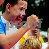 JIM VAIKNORAS/Staff photo Will Flahrety, 11, of Reading, pumps his fists after winning the pie eating contest at the Reading Fall Street Fair. Will was defending his title having won th eevent last year.