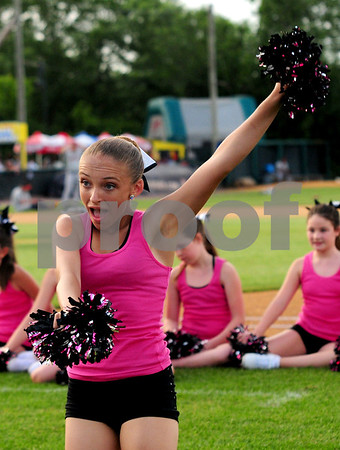 JIM VAIKNORAS/Staff photo  Lizzie Barrett of the Fusion Dance Team from The Dancing School in North Reading performs at the Lowell Spinners game on July 17th.