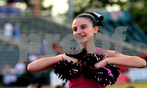 JIM VAIKNORAS/Staff photo  Gianna Costa of the Fusion Dance Team from The Dancing School in North Reading performs at the Lowell Spinners game on July 17th.