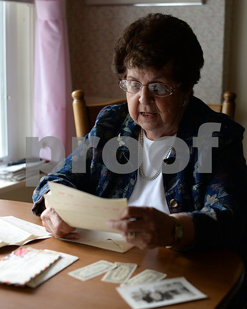 """RYAN HUTTON/ Staff photo<br /> North Andover's Josephine DiMauro recently came across more than a half dozen letters she got from CJ """"Jimmy"""" Arsenault, a Marine pilot and Reading native she was pen pals with during World War II."""