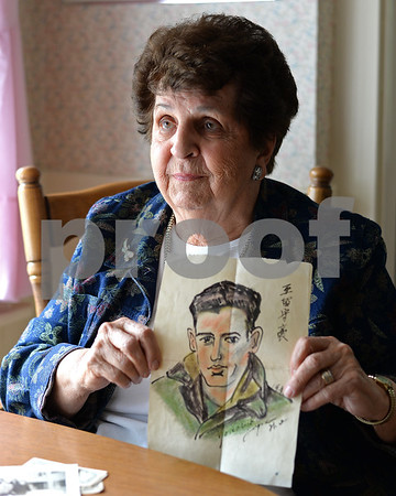 """RYAN HUTTON/ Staff photo<br /> North Andover's Josephine DiMauro recently came across more than a half dozen letters she got from CJ """"Jimmy"""" Arsenault, a Marine pilot and Reading native she was pen pals with during World War II. Among the things he sent her was this drawing of himself done by a Japanese boy when Arsenault was part of the occupying force in Japan after the war."""