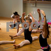 JIM VAIKNORAS/Staff photo Competitive dance team members Emma Keefe,9, and Ainsley Lowton , 10, stretch during class at Lapierre Dance School.