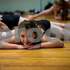 JIM VAIKNORAS/Staff photo Julia Mazmania, 9, of Stoneham stretches wit the Competitive Dance Team at Lapierre Dance Studio.